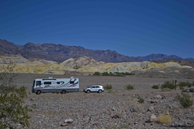 Motorhome towing car through Death Valley National Park.