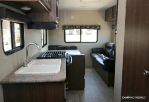 Shown above: Rear dinette and sofa, folds down to make two beds.