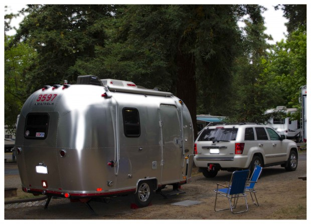 A small Airstream trailer can be towed by a car.