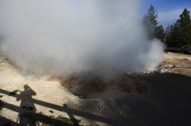 "Steaming pool of water at Yellowstone ""selfie"" photo."