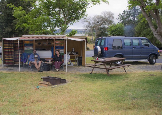 Some folks enjoy the van for sleeping and a homemade canvas tent trailer used for a sheltered sitting area, kitchen and dressing room.