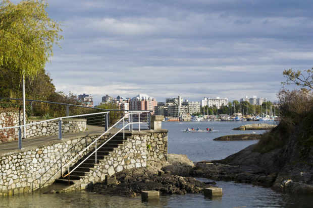 You can take a water taxi or walk three miles along the West Bay Walkway into Victoria.