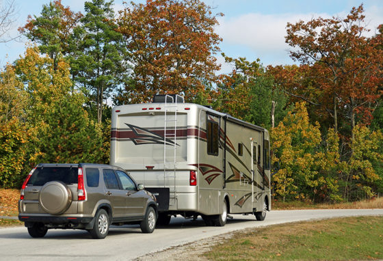 Motorhome towing an SUV photo